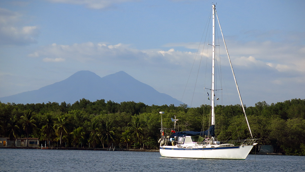 Distant Drummer anchored in the lagoon at Bahia del Sol with Volcan San Miguel behind