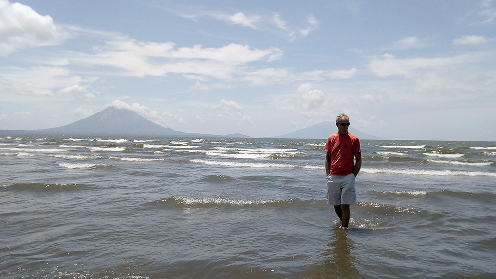 Neil paddling in Lake Nicaragua with Isla Onetepe in the background